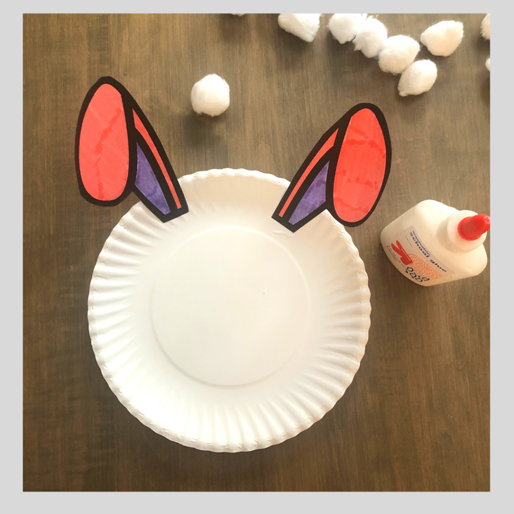 Glue the bunny ears on the paper plate craft.